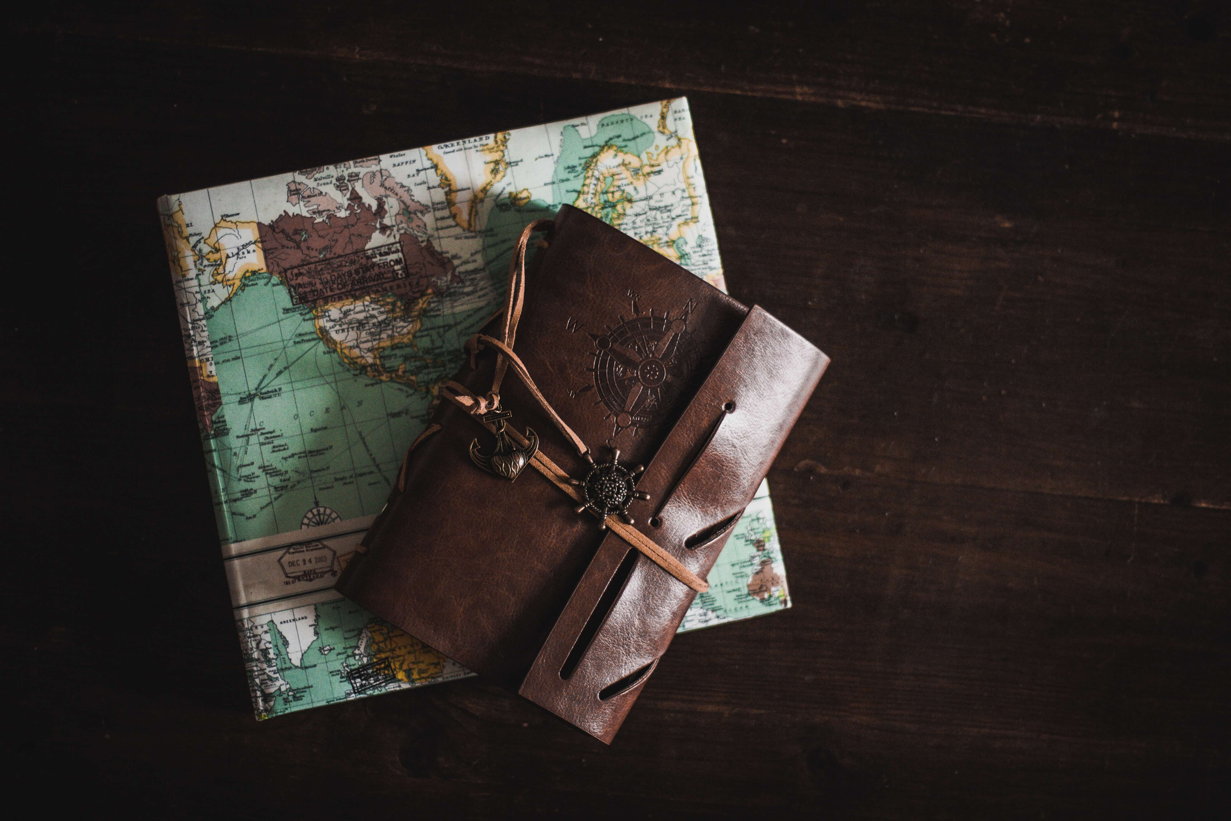 map-compass-book-wooden-table