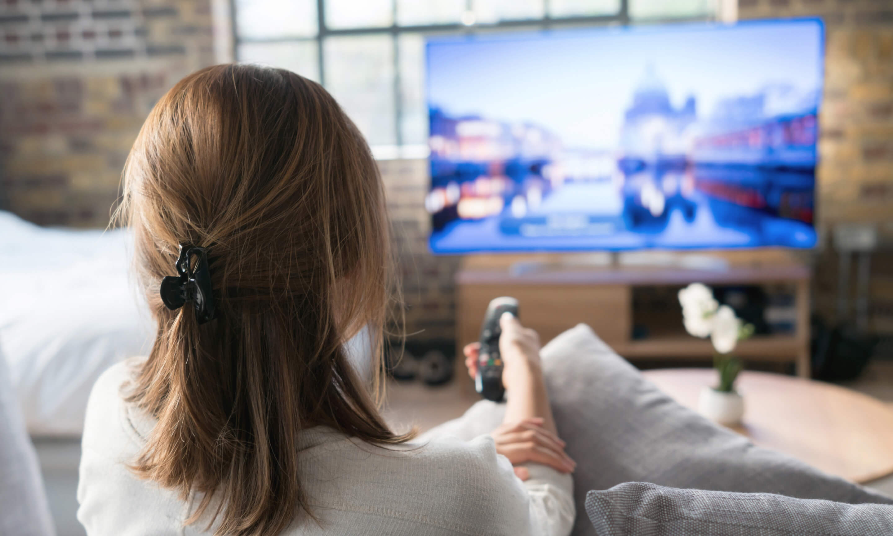 Woman Watching TV | Infinity Marketing | Integrated Marketing Agency | Greenville, SC