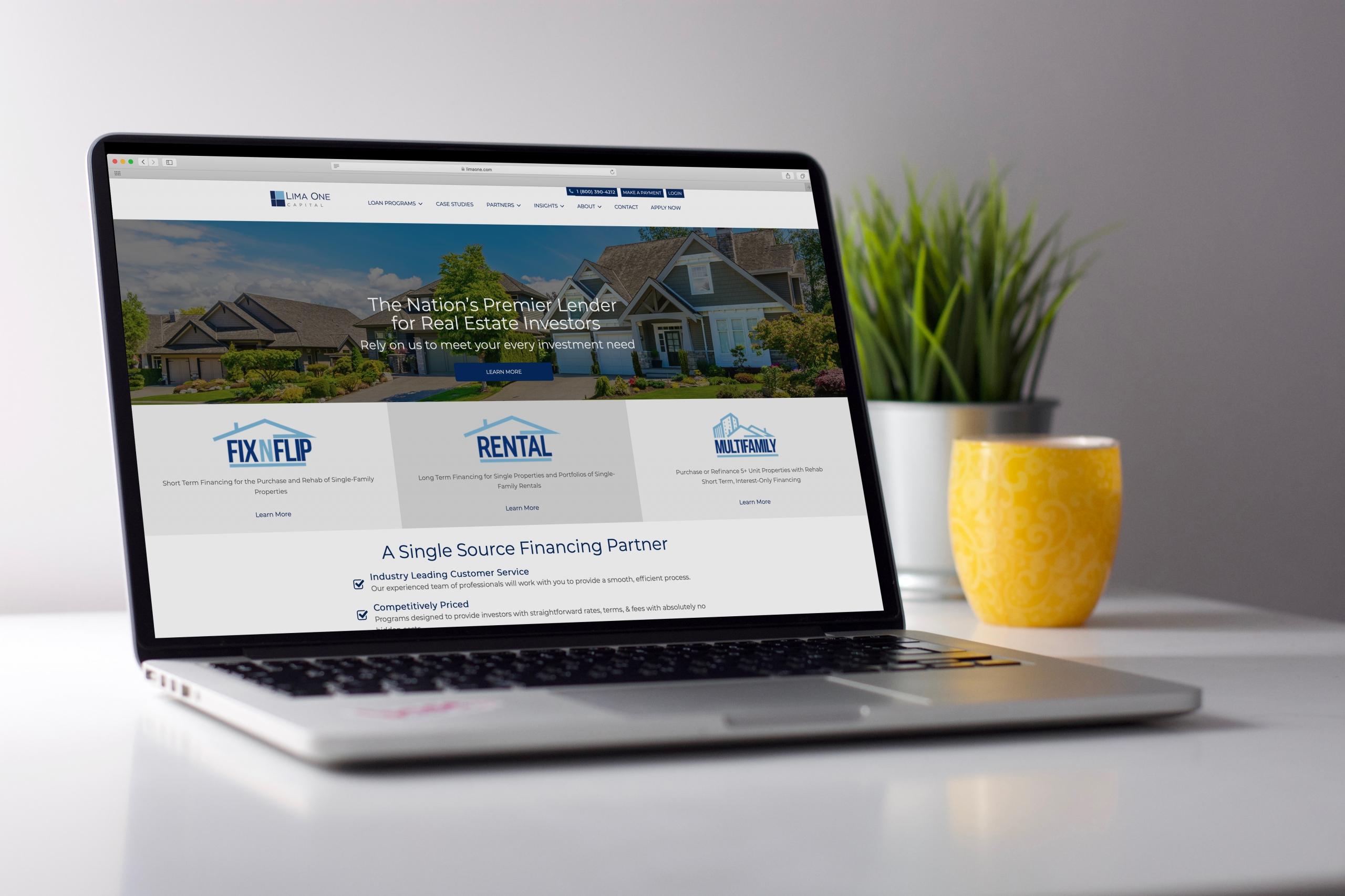 lima one capital website on laptop