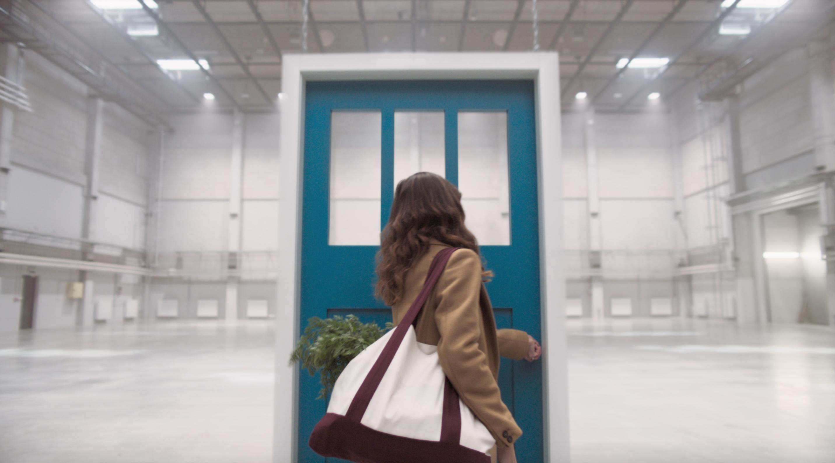 girl walking through door