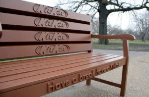 example of guerrilla marketing on park bench
