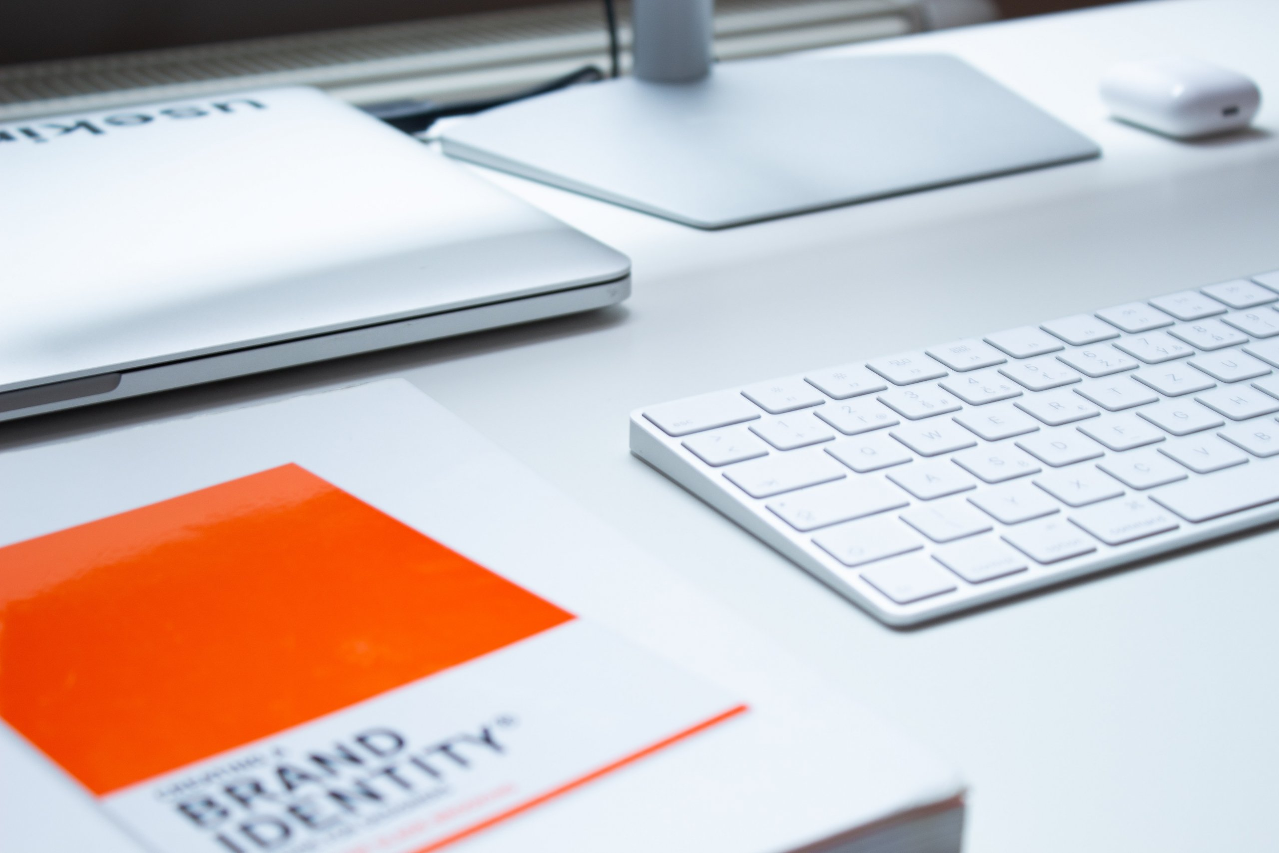 brand identity book on a desk with a computer and keyboard