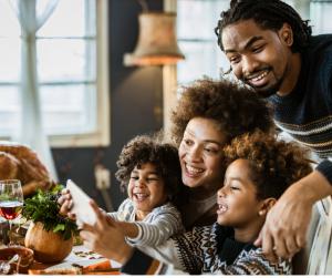 family taking a selfie at thanksgiving dinner